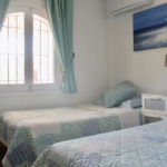 2 Bedrooms both with twin bed's, air con and fitted wardrobes / drawers.